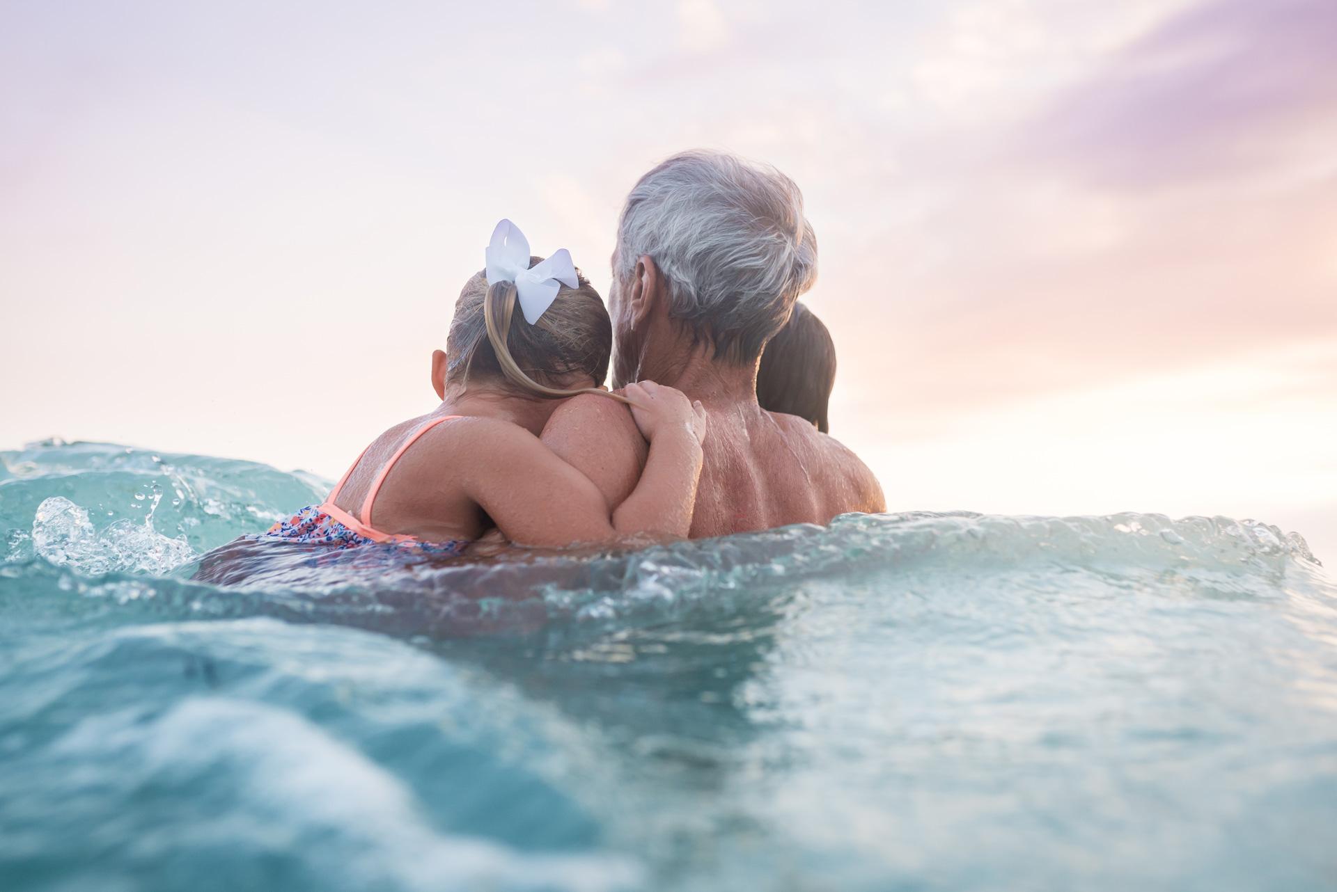 Grandpa with children in water