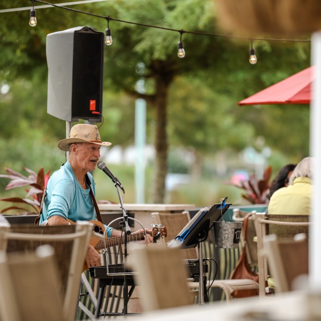 Restaurant with outdoor seating and live entertainment