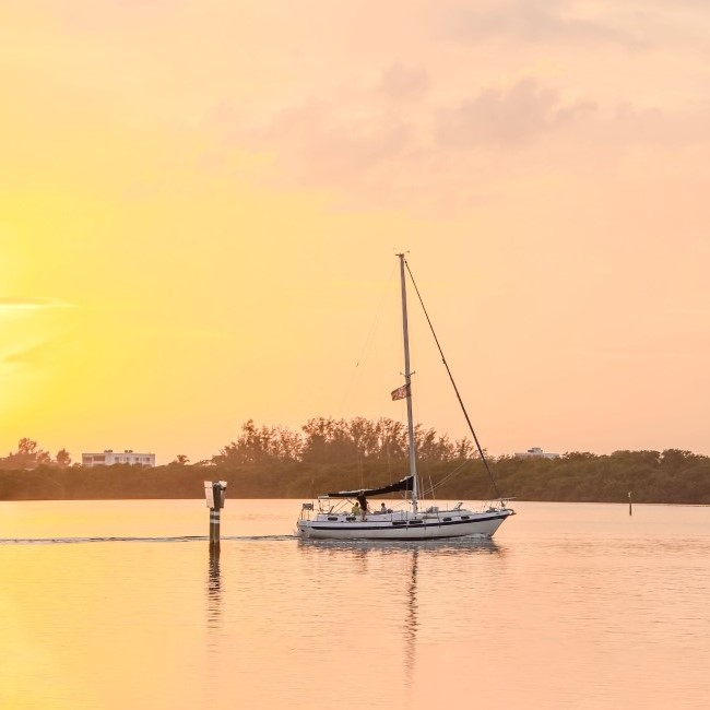 Sailboat at sunset - Michael Saunders & Company
